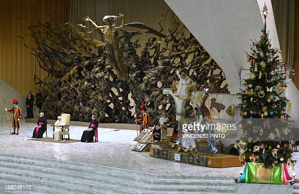 Pope Benedict XVI sits by a crib during his weekly general audience on December 12 2012 at the Paul VI hall at the Vatican AFP PHOTO / VINCENZO PINTO