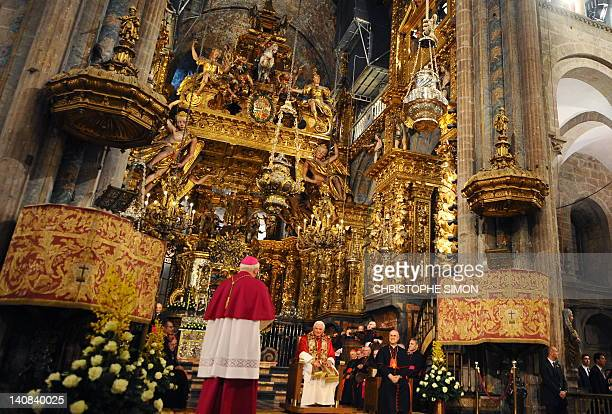 Pope Benedict XVI sits under the Botafumeiro a giant thurible hanging from the dome of the Santiago de Compostela cathedral on November 6 2010 during...