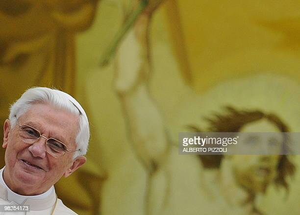 Pope Benedict XVI smiles as he blesses the pilgrims gathered for his Regina Coeli prayer in the courtyard of Pontiff's residence in Castelgandolfo,...