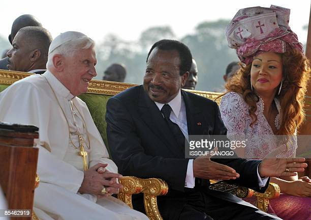Pope Benedict XVI speaks to Cameroonian President Paul Biya and his wife Chantal on March 17 2009 on arrival at the airport in Yaounde Pope Benedict...