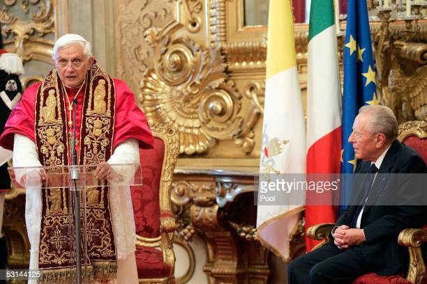 Pope Benedict XVI speaks while Italy's President Carlo Azeglio Ciampi listens during the official visit at the Quirinale Presidential palace June 24...