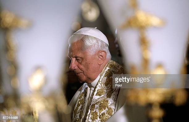 Pope Benedict XVI stands in front of the Stone of Anointing where Christians believe the body of Jesus was prepared for burial in the Church of the...