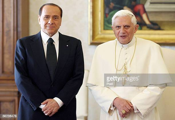 Pope Benedict XVI stands with Italian Prime Minister Sivio Berlusconi during their meeting November 19 2005 in Vatican City This is the first meeting...