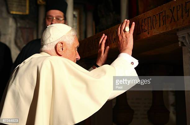 Pope Benedict XVI touches the traditional site where Jesus was crucified in the Golgotha or Calvary in the Church of the Holy Sepulchre on May 15...