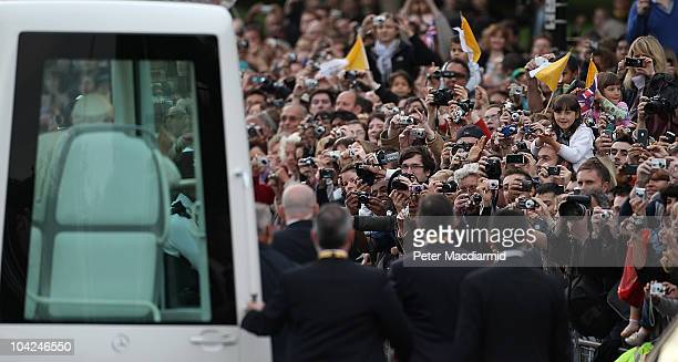 Pope Benedict XVI travels along the Mall in his popemobile to attend a prayer vigil in Hyde Park on September 18 2010 in London England Pope Benedict...