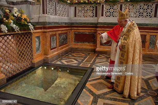 Pope Benedict XVI visits the crypt of St Paul the Apostle during Vesper prayers at the Basilica of St Paul's Outside the Walls in Rome