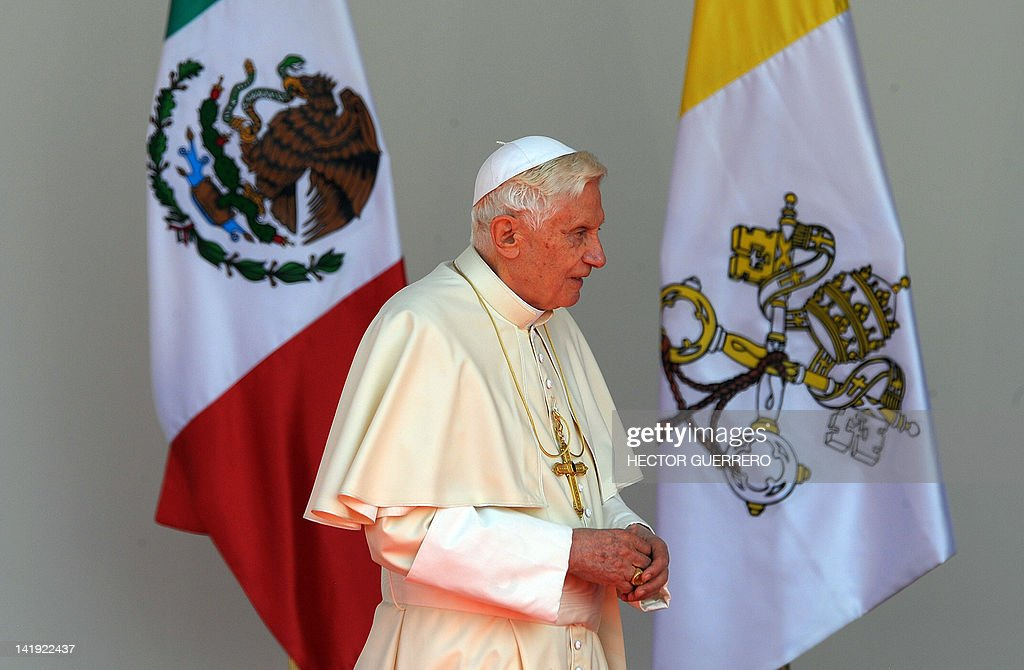 Pope Benedict XVI walks during a farewell ceremony, at Silao's international airport in Guanajuato, Mexico, on March 26, 2012. Benedict XVI headed to Cuba hoping to boost the Catholic Church's special dialogue with the Communist regime, as dissidents said a wave of arrests aimed to thwart demonstrations. AFP PHOTO/Hector GUERRERO