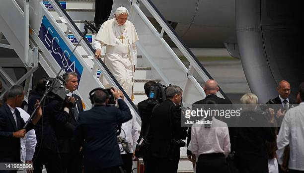 Pope Benedict XVI walks off his plane after arriving at the Jose Marti International airport on the second day of his three-day visit on March 27,...