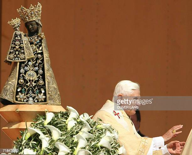 Pope Benedict XVI walks past the Black Madonna as he celebrates the second open air mass of his visit to his native Bavaria region 11 September 2006...