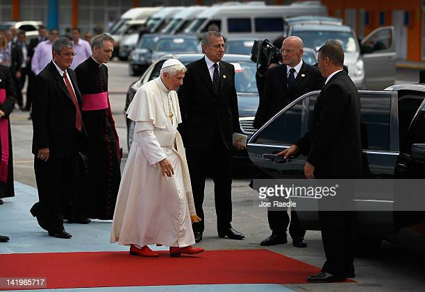 Pope Benedict XVI walks to his car during a welcoming ceremony after arriving at the Jose Marti International airport on the second day of his...