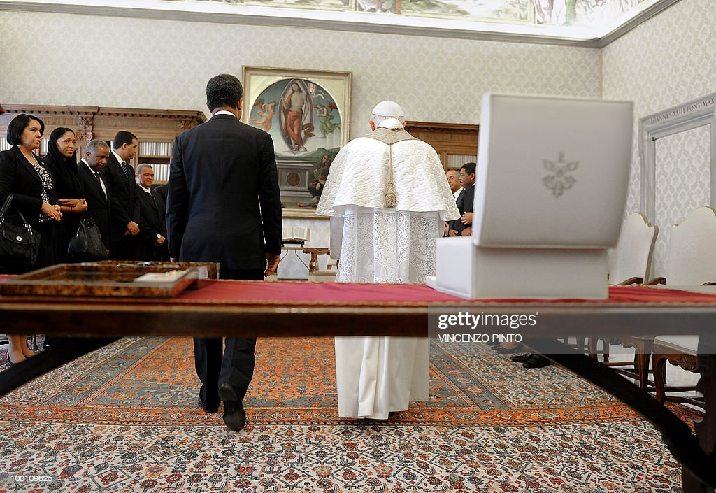 Pope Benedict XVI walks with Dominican Republic's President Leonel Fernandez (L) at the end of a private audience in the pontiff's private studio at the Vatican on May 21, 2010.