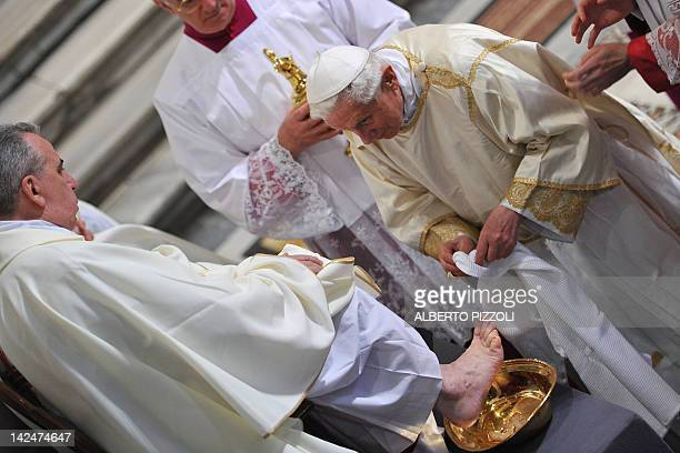 Pope Benedict XVI washes feet of priests during the Mass of the Lord's Supper on Holy Thursday on April 5, 2012 at the basilica of Saint John Lateran...
