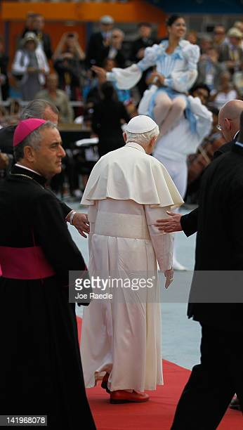 Pope Benedict XVI watches a performance of dancers after walking off his plane after arriving at the Jose Marti International airport on the second...