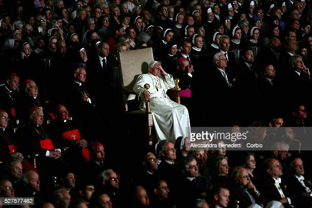 Pope Benedict XVI watches the movie Karol un uomo divenuto papa in memory of the late Pope John Paul II in the Paul VI Hall at the Vatican