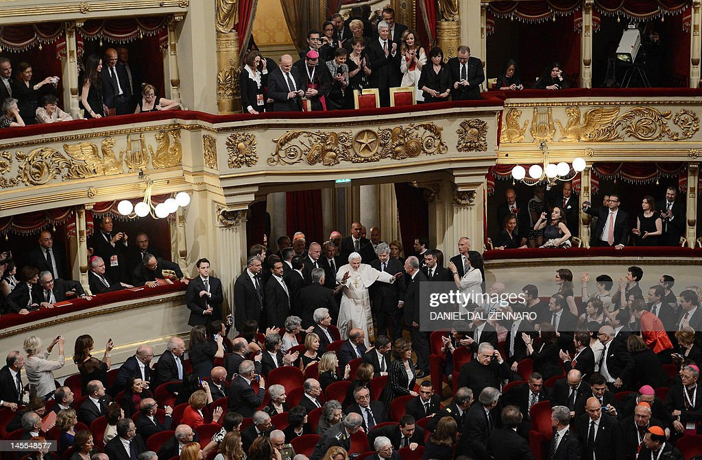 Pope Benedict XVI (C) waves as he arrives at La Scala theatre in Milan on June 1, 2012 during the 7th World Meeting of Families. Benedict attended a concert at the prestigious Scala opera house to hear Beethoven's Ninth Symphony conducted by Daniel Barenboim.