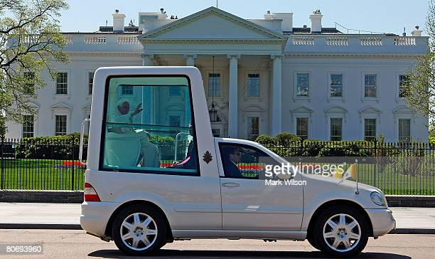 Pope Benedict XVI waves as he rides in the Popemobile as he departs the White House after meeting with US President George W Bush April 16 2008 in...