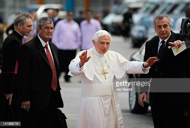 Pope Benedict XVI waves as he walks to his car during a welcoming ceremony after arriving at the Jose Marti International airport on the second day...