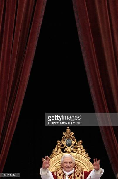 Pope Benedict XVI waves during the 'Urbi et Orbi' address in St Peter's square at the Vatican on December 25 2008 The Pontiff in his Christmas...