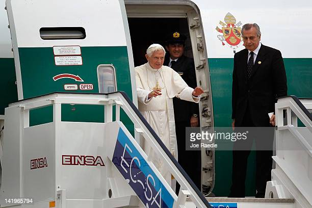 Pope Benedict XVI waves from his plane after arriving at the Jose Marti International airport on the second day of his three-day visit on March 27,...