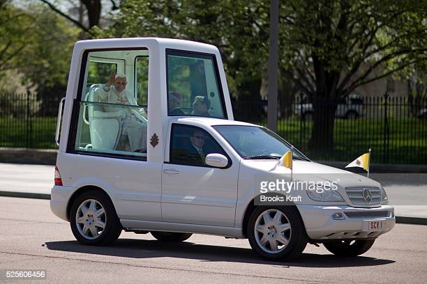 Pope Benedict XVI waves from the popemobile as he drives in front of the White House in Washington.