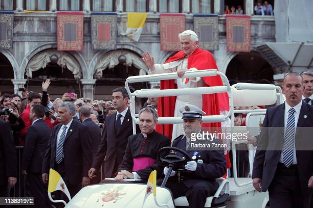 Pope Benedict XVI waves from the Popemobile as he is driven around Saint Mark's Square on May 7 2011 in Venice Italy Pope Benedict XVI is visiting...