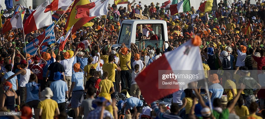 Pope Benedict XVI waves to the crowd at his arrival at the Cuatro Vientos Airport for the closing ceremony of the World Youth Day 2011 on August 21, 2011 in Madrid, Spain. Initiated by Pope John Paul II in 1985, World Youth Day youth-oriented events for the celebration of the Catholic faith are held every three years in a different country; this time in Madrid from August 16th to 21st, 2011.