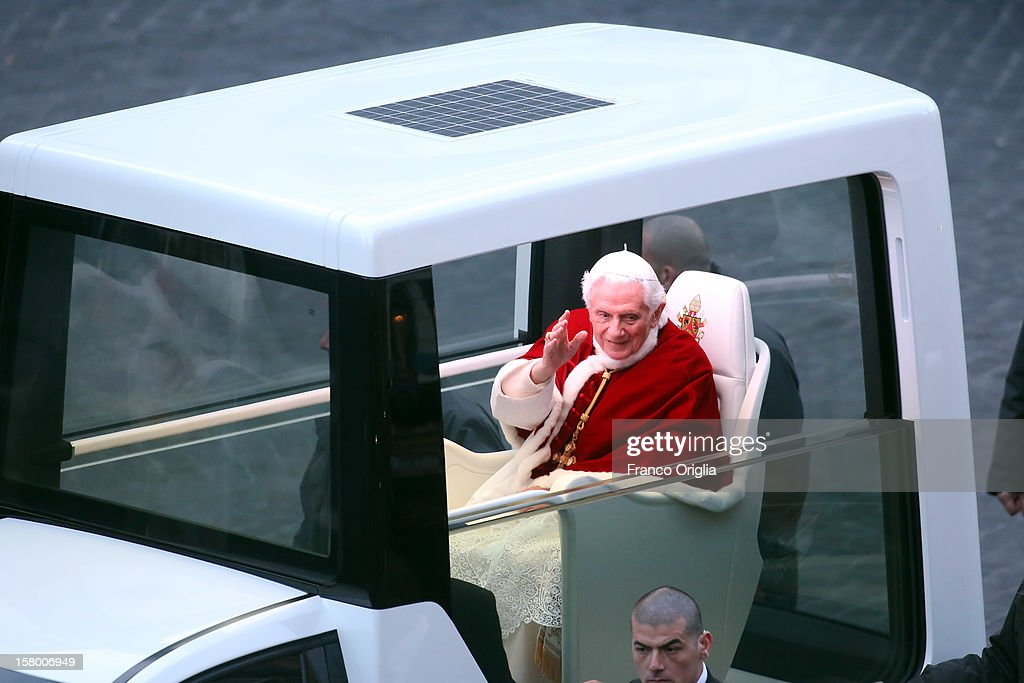 Pope Benedict XVI waves to the faithful as he arrives in his new Popemobile at the Spanish Steps for the celebration of the Immaculate Conception on December 8, 2012 in Rome, Italy. This papal tradition marks the beginning of the Christmas season as the Pope visits the monument and crowns the statue of Mary with a garland of flowers.