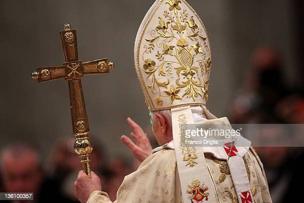 Pope Benedict XVI waves to the faithful as he arrives in St Peter's Basilica for the Christmas night mass on December 25 2011 in Vatican City Vatican