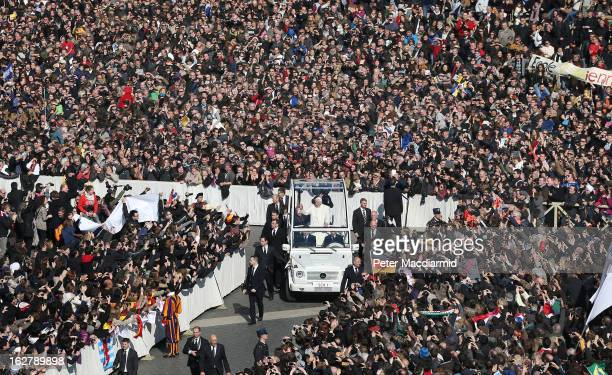 Pope Benedict XVI waves to the faithful from the Popemobile as he arrives in St Peter's Square on February 27 2013 in Vatican City Vatican The...