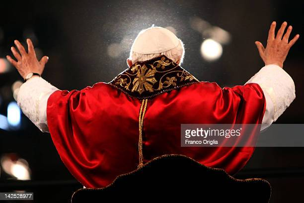 Pope Benedict XVI waves to the faithful gathered at the Colosseum during the Way Of The Cross procession on Good Friday April 6 2012 in Rome Italy...