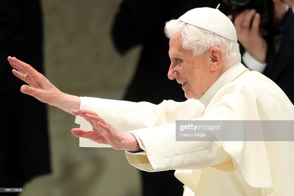 Pope Benedict XVI waves to the faithful gathered at the Paul VI Hall during his weekly audience on January 9, 2013 in Vatican City, Vatican. PThe Pontiff gave the catechesis dedicated to the Year of Faith, during his regularly scheduled Wednesday general audience.