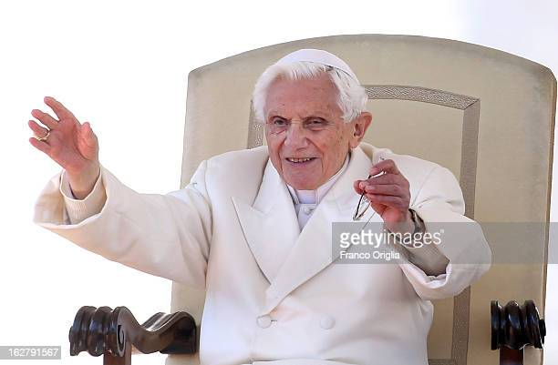 Pope Benedict XVI waves to the faithful gathered in St Peter's Squareduring his final general audience on February 27 2013 in Vatican City Vatican...