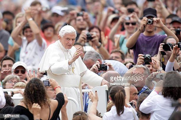 Pope Benedict XVI waves to the faithful gathered in St Peter's Square during his weekly audience on September 26 2012 in Vatican City Vatican The...