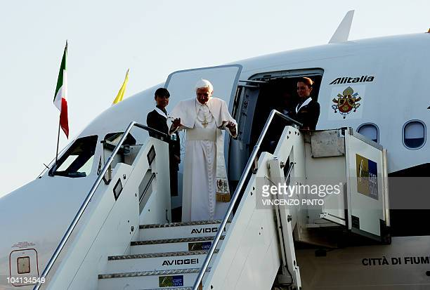 Pope Benedict XVI waves upon boarding a plane on his way to Scotland Ciampino airport south east of Rome on September 16 2010 The pontiff begins a...