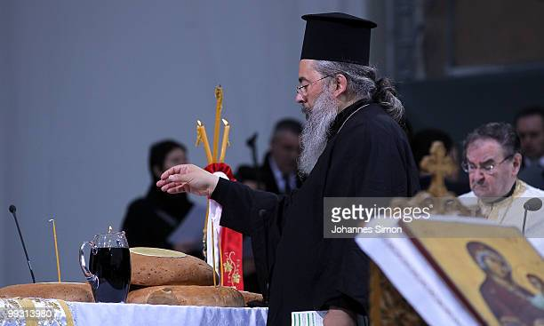 A pope blesses bread and wine during the celebration of Greek orthodox vespers during day 3 of the 2nd Ecumenical Church Day at Odeonsplatz square on...