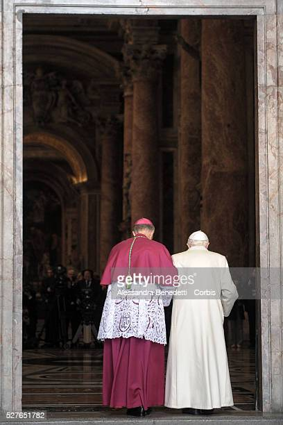 Pope emeritus Benedict XVI enters the Holy Door at St Peter's Basilica on the opening day of the Extraordinary Jubileum of Mercy at the Vatican and...