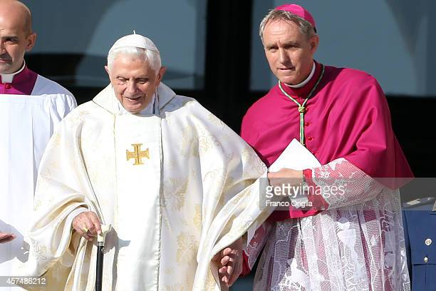 Pope Emeritus Benedict XVI flanked by Prefect of the Pontifical House and his former personal secretary Georg Ganswein arrives at the holy mass for...