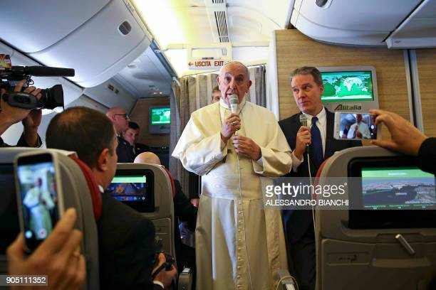 Pope Francis addresses journalists aboard the plane for his trip to Chile and Peru on January 15 2018 / AFP PHOTO / POOL AND AFP PHOTO / ALESSANDRO...