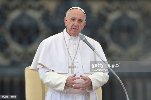 Pope Francis addresses the crowd during his weekly general audience at St Peter's square on February 3 2016 at the Vatican AFP PHOTO / TIZIANA FABI /...
