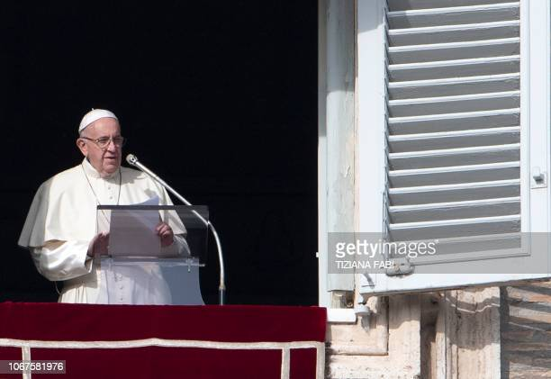 Pope Francis addresses the crowd from the window of the apostolic palace overlooking Saint Peter's square during his Sunday Angelus prayer on...
