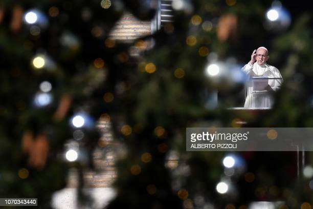 TOPSHOT Pope Francis addresses the crowd from the window of the apostolic palace overlooking Saint Peter's square at The Vatican during his Sunday...