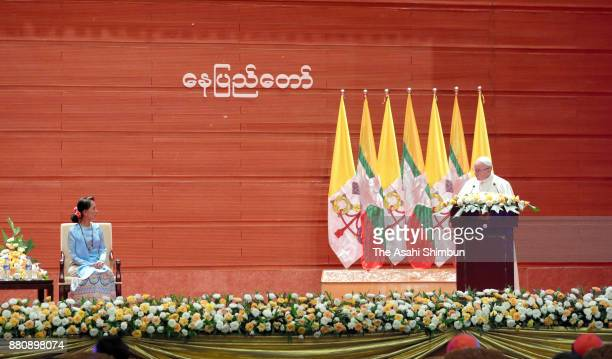 Pope Francis addresses while State Counsellor Aung San Suu Kyi listens on November 28 2017 in Nay Pyi Taw Myanmar