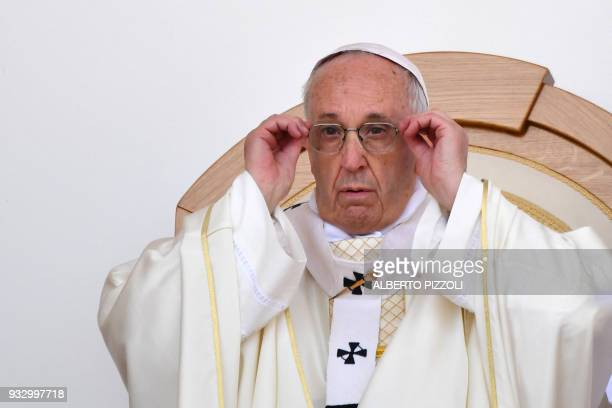 Pope Francis adjusts his glasses during a mass in San Giovanni Rotondo on March 17 2018 as part of a pastoral visit on the 50th anniversary of the...