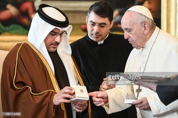Pope Francis and Bahrain's Crown Prince Salman bin Hamad bin Isa alKhalifa exchange gifts on February 3 2020 during a private audience at the Vatican