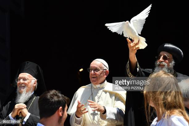 Pope Francis and Ecumenic Patriarch of the Orthodox Church Bartolomeo I watch as Egypt's Coptic Orthodox Pope Tawadros II releases a dove after a...