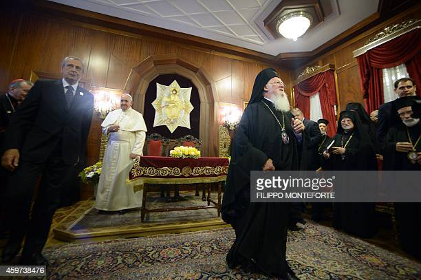 Pope Francis and Ecumenical Patriarch Bartholomew I leave after they signed a joint statement at St George church the principal Greek Orthodox...