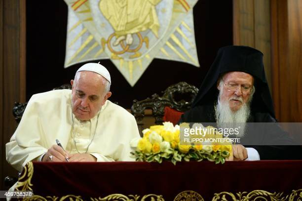 Pope Francis and Ecumenical Patriarch Bartholomew I sign a joint statement at St George church the principal Greek Orthodox cathedral on November 30...