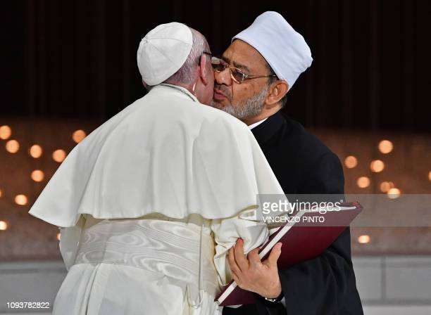 TOPSHOT Pope Francis and Egypt's Azhar Grand Imam Sheikh Ahmed alTayeb greet each other as they exchange documents during the Human Fraternity...