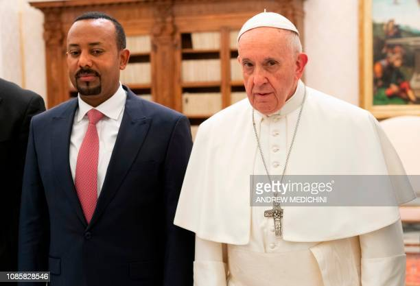 Pope Francis and Ethiopian Prime Minister Abiy Ahmed pose during a private audience at the Vatican on January 21, 2019.