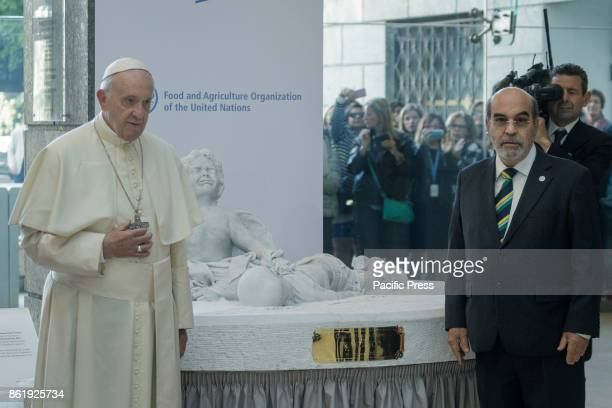 Pope Francis and Jose Graziano Da Silva FAO DirectorGeneral stands next a marble statue representing the tragedy of migration donated by Pope Francis...